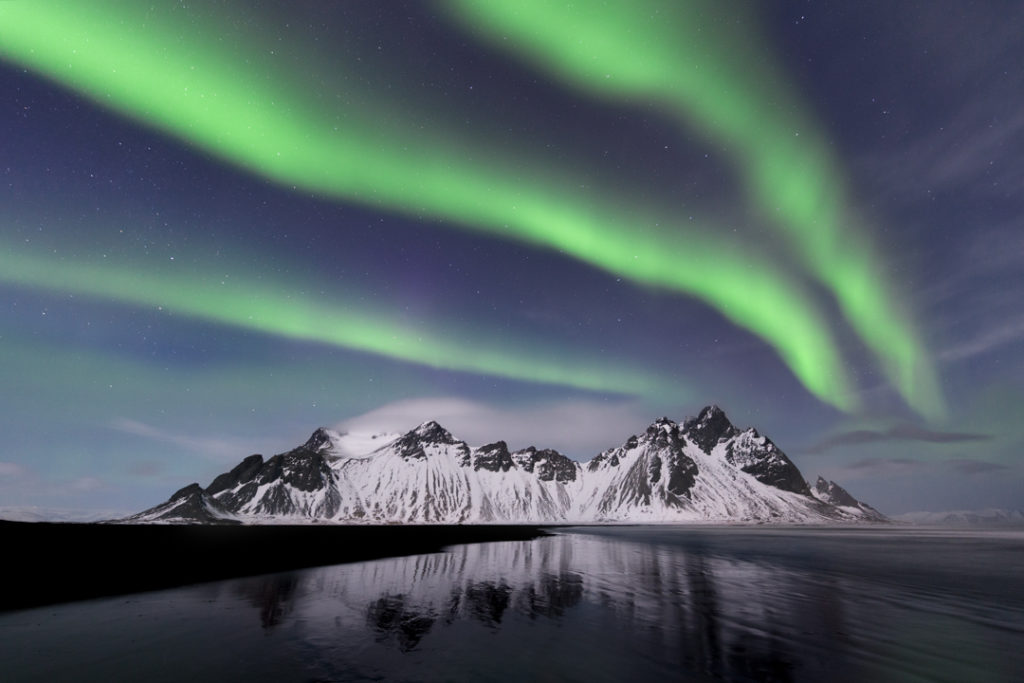The aurora borealis and the Vestrahorn, Eastern Iceland.