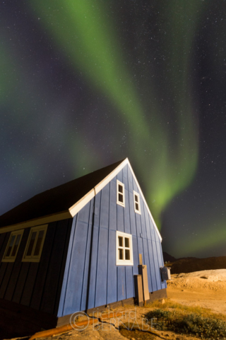 The Aurora Borealis over the village of Tasiilaq, Greenland